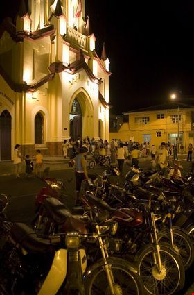 Scooters parked in front of the church