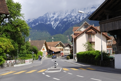 Photo City Street and Swiss Alps in Interlaken - Pictures and Images of Interlaken