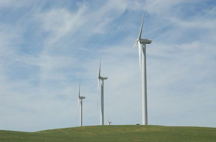 Photo A row of wind turbines on a hill in Fairfield - Pictures and Images of Fairfield