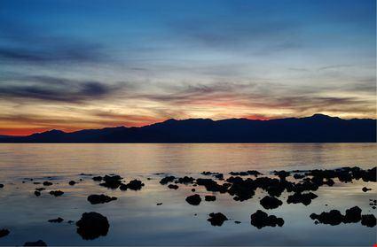 Rocks in water along lake shore
