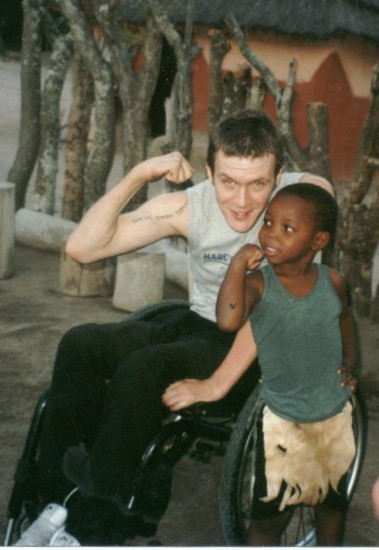 Photo Wheelchair traveller Ben with African village boy in Johannesburg - Pictures and Images of Johannesburg
