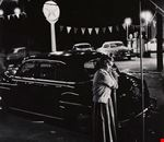 3. Eugene Smith_Girl leaning on a parking meter.jpg