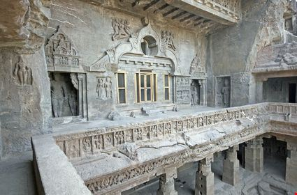 Facade of ancient rock carved Buddhist temple