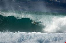 Surfer deep in the barrel of a wave