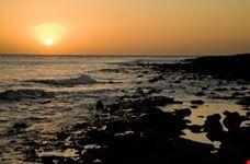 Sunset over a rocky beach