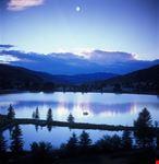 Mountain moonset over lake