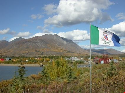 Yukon flag flying and Caribou Mountain behind