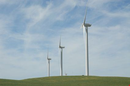 A row of wind turbines on a hill