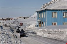 Wooden House and snowmobile of Spitsbergen