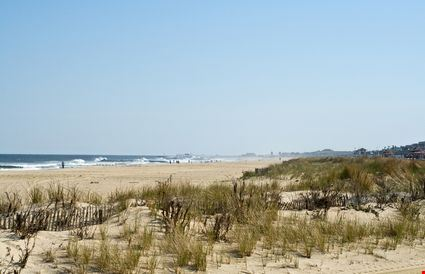 View of sand dunes beach and ocean along the jersey shore