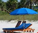 Blue umbrella and chairs