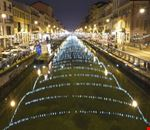 naviglio grande lit up at night milan